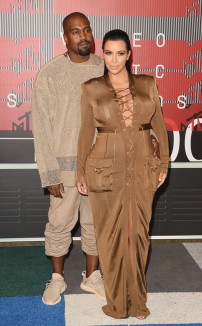 1/10 Kim in a tan coloured Balmain dress. Their outfits were mediocre and Kanye's style of ill-fitting clothes certainly isn't for everyone. Jason Merritt/ Getty Images