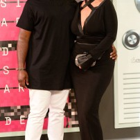 10/10 Corey Gamble and Kris Jenner matching in monochrome. Keeping it sexy but age appropriate. Frazer Harrison/ Getty Images
