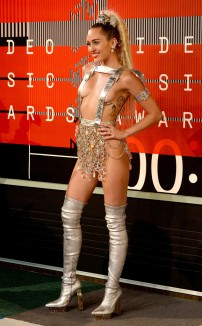 1/10 Meh... Miley Cyrus in a silver Versace gown, just doesn't do it for me. She definitely made her presence known! Frazer Harrison/ Getty Images