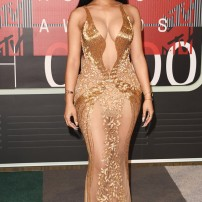 10/10 Nicki Minaj staying true to her daring persona in this revealing gold Labourjoisie gown. Inspiration from Beyonce's Met Gala outfit perhaps? Jason Meritt/ Getty Images
