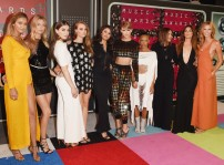 10/10 Taylor Swift and her squad of beautiful women, all looking classy and modern. Taylor clearly stealing the show... Jason Merritt/ Getty Images